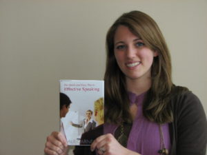 The Secret of My Success.  Kim Hartzler holds one of the texts used to develop sales acumen in the Dale Carnegie Course.